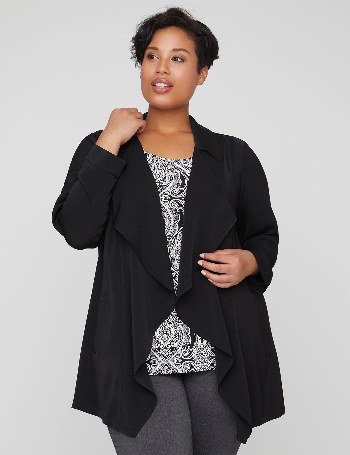 "A charming overpiece that brings flattering movement thanks to the cascading folds along the open-front design. Elastic gathering at back waist to compliment your silhouette. Long sleeves. Side pockets. Split side hem. Item Number #315374, 93% Polyester/7% Spandex, Machine Wash, Imported Plus Size Top, Length: 34"" , Plus Sizes 0X-5X, Petite Plus Sizes 0XWP-3XWP, Catherines Plus Sizes"